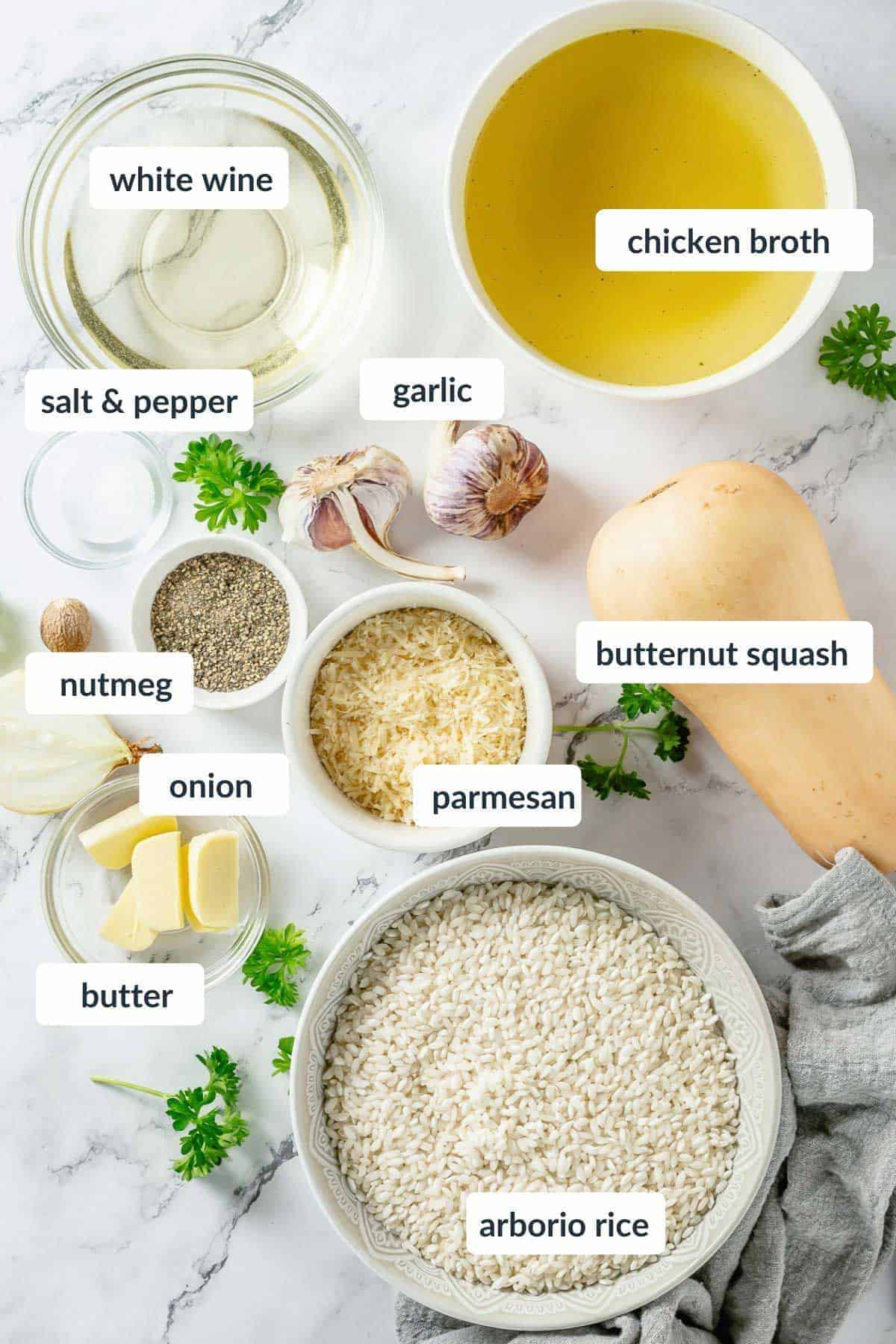 squahs risotto ingredients flatlay shot over marble background
