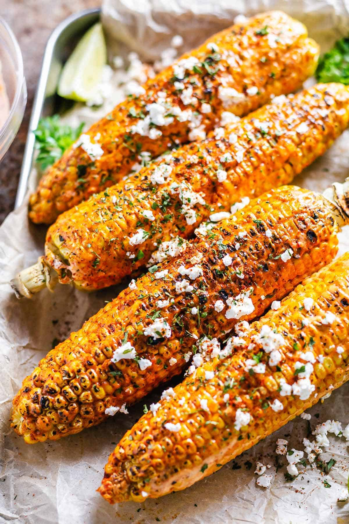 flat lay shot of cajun on the cob on a white plate
