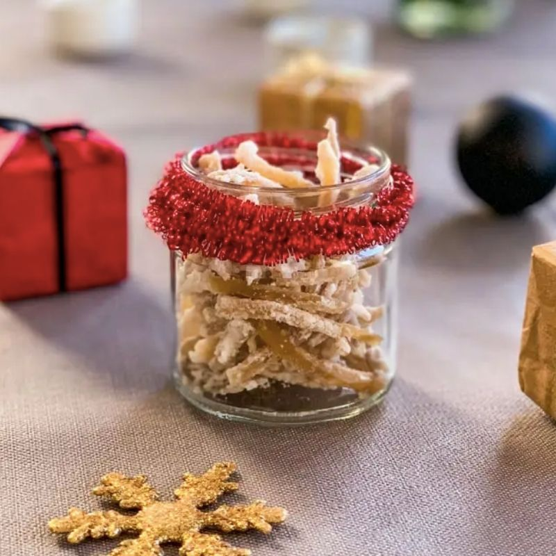 Candied Ginger in a small glass jar wrapped with red ribbon