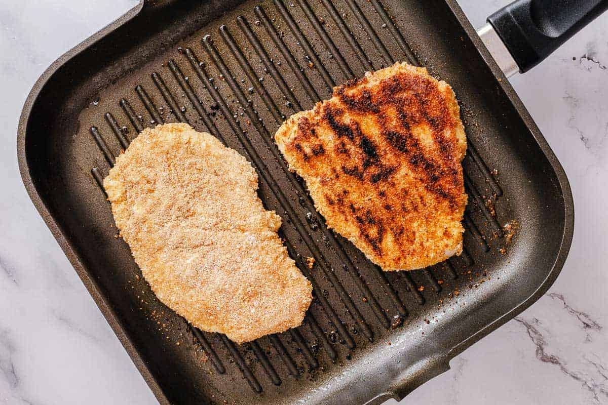 breaded chicken fried on a grill pan