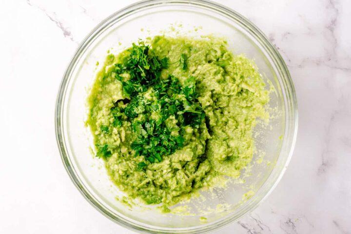 Simple Guacamole recipe process shots - mashed avocado with cilantro