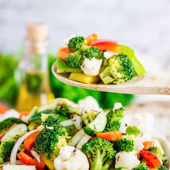 close up shot of a marinated broccoli and cauliflower salad