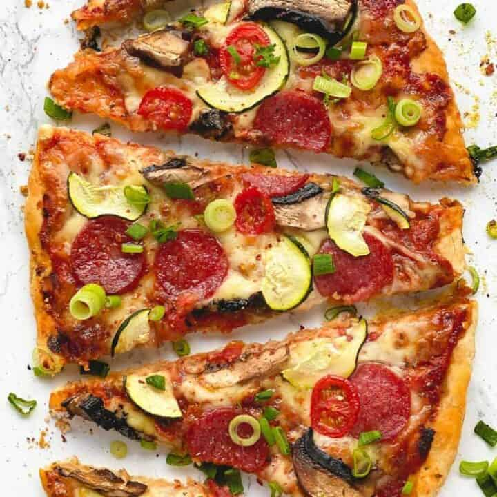 This flavourful and fresh pepperoni, zucchini tomato flatbread is so simple to make and is loaded only with the best toppings to be served as an appetizer for breakfast, lunch, or dinner table. - The Yummy Bowl