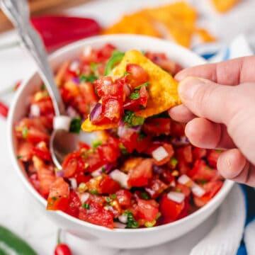pico de gallo (mexican tomato salsa) in a bowl with tortilla chips