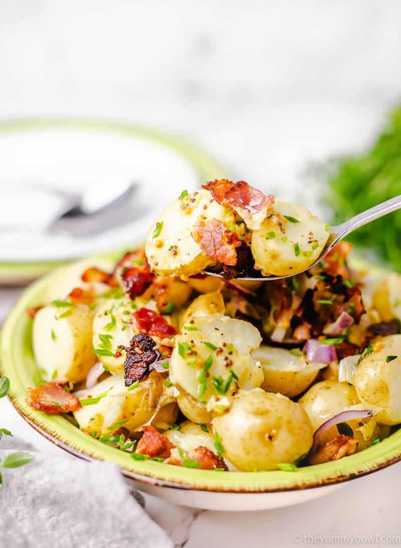 potato salad on a green plate bowl
