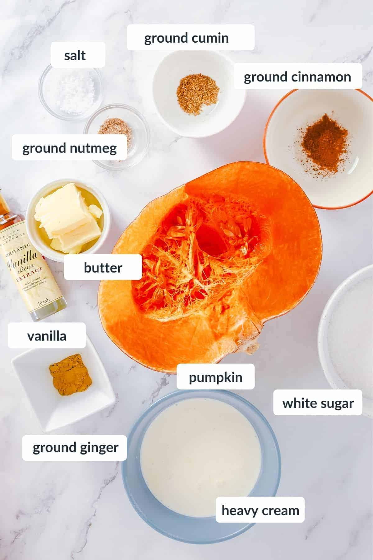 Ingredients for pumpkin caramel on a marble table