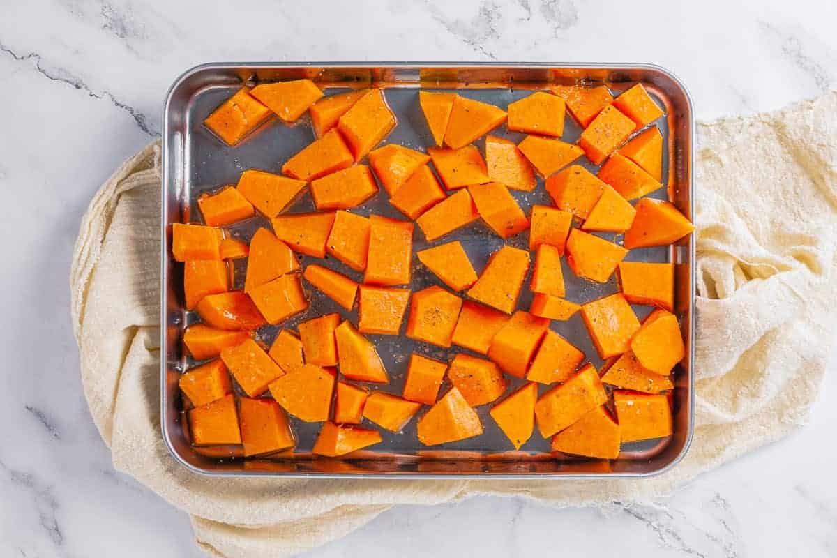 pumpkin chunks before roasting on a metal baking tray