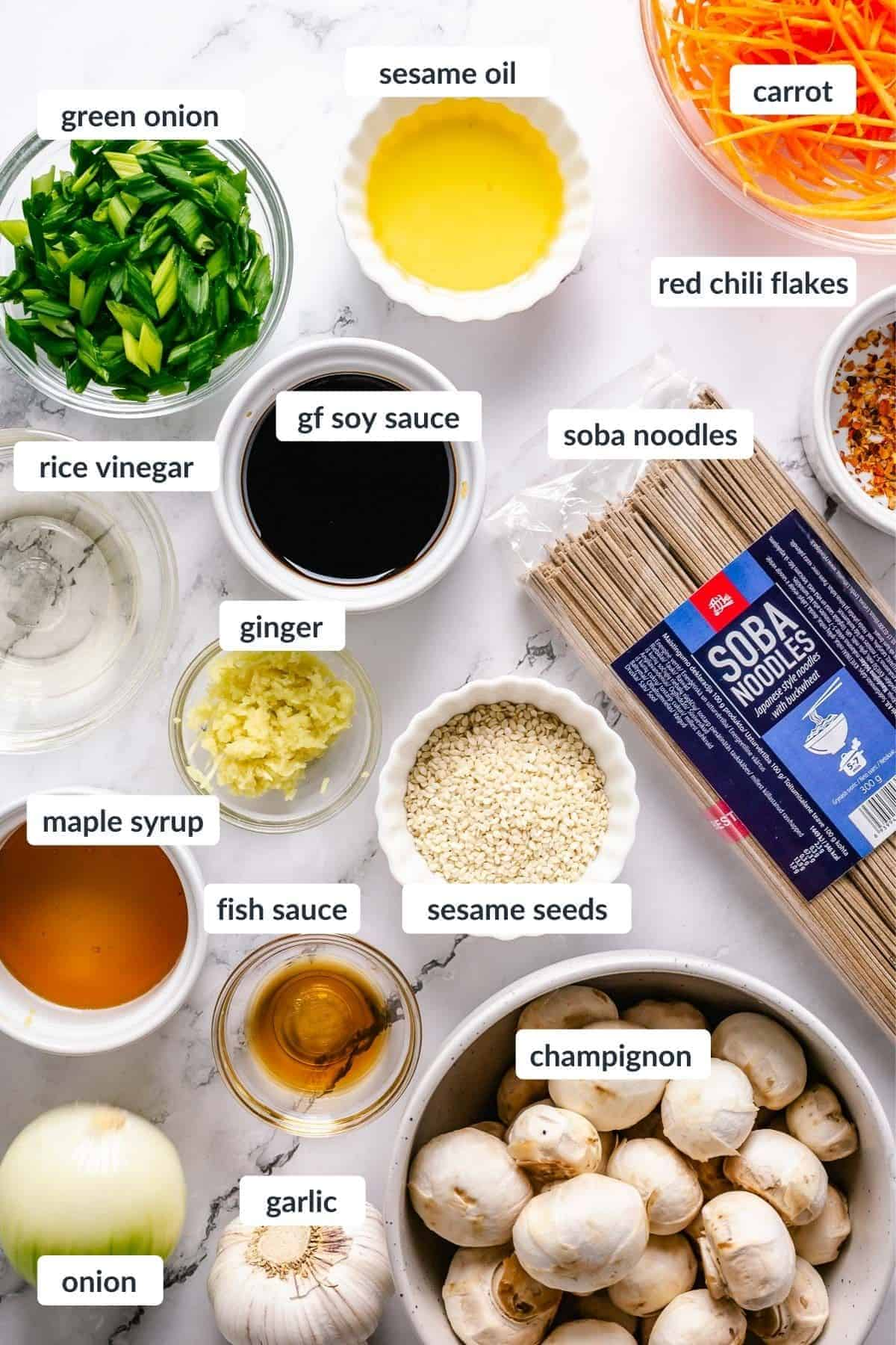 Stir Fry Soba Noodles ingredients on a white marble background flatlay