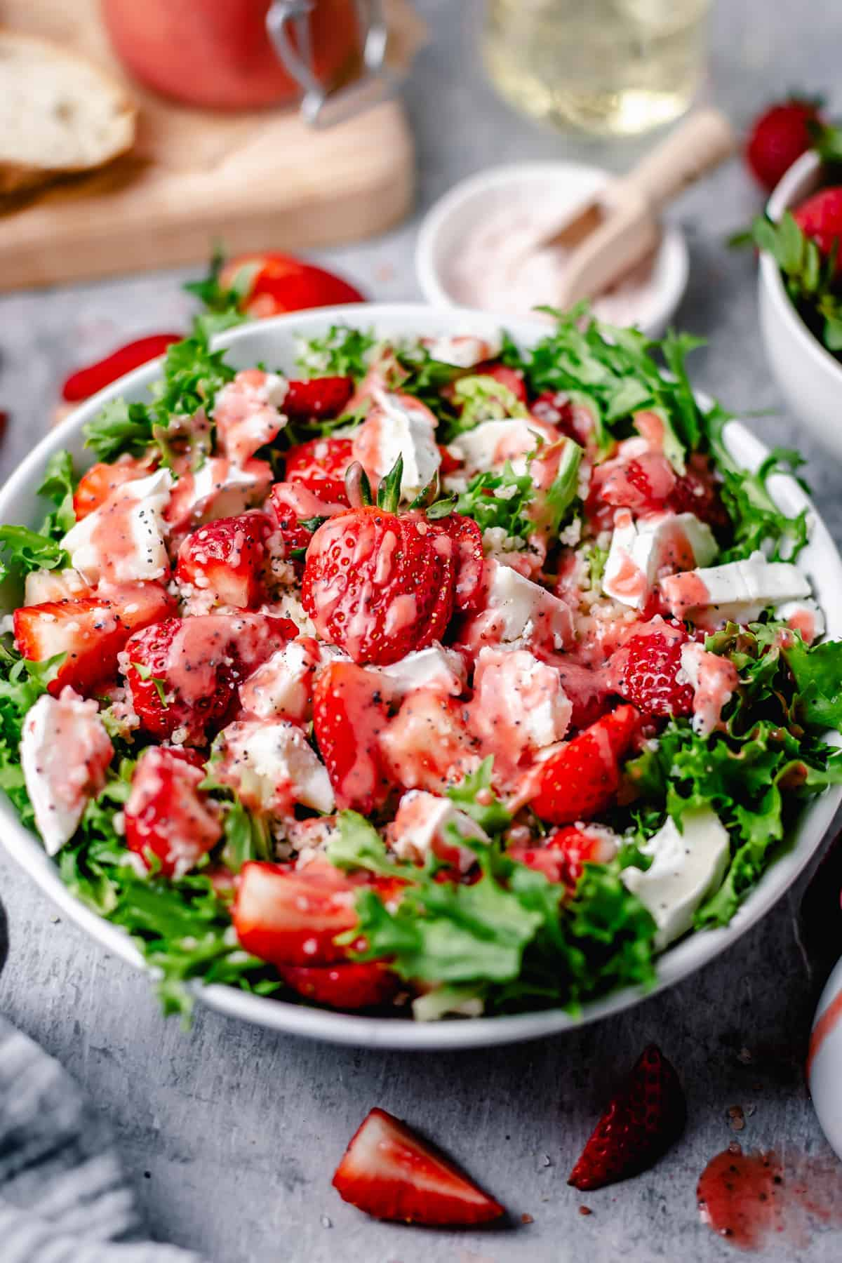 bright strawberry salad in a white bowl