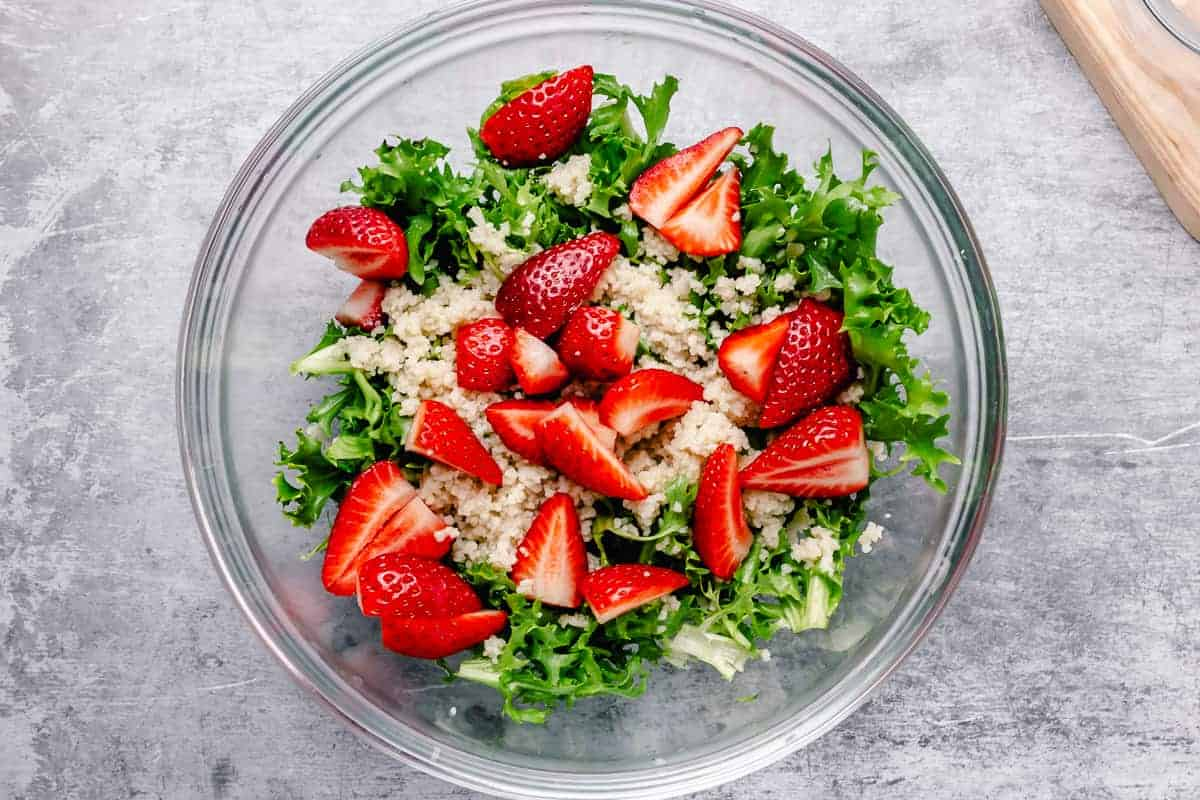 bright strawberry salad in a white bowl