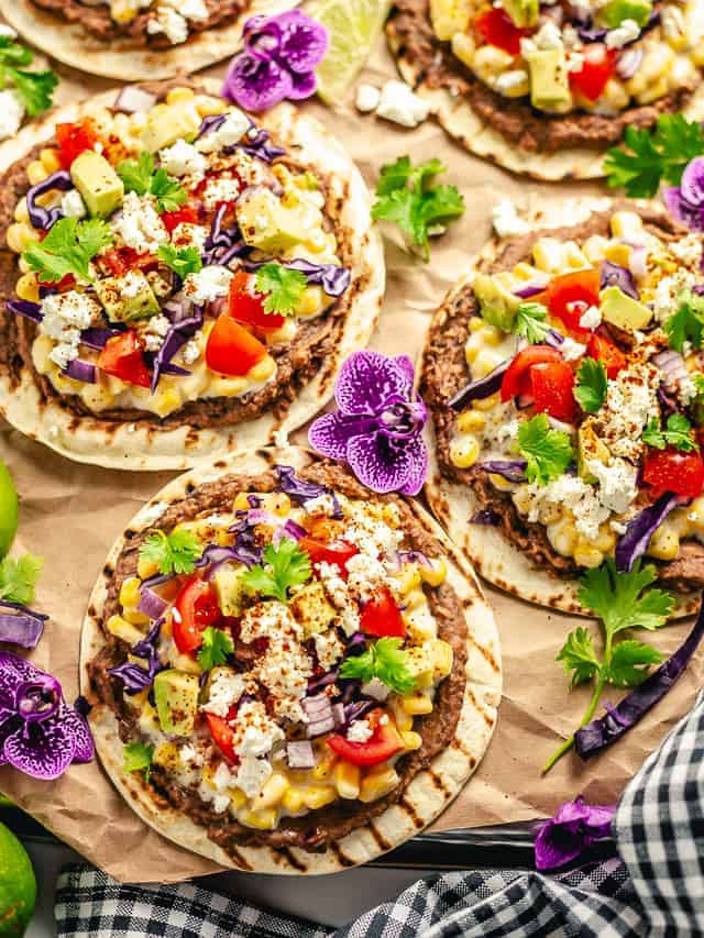 tostadas with toppings on a brown parchment paper