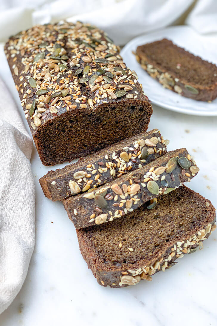 This Sunflower and Flaxseed Bread is a tender, moist, fiber-rich loaf that is packed with flaxseeds, sunflower, chia, and cumin seeds. This easy to make quick bread is perfect for breakfast, a mid-morning snack, or your favorite toasts spread.