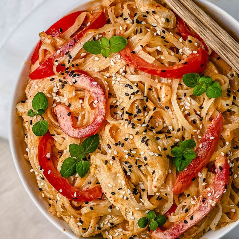 These Thai Red Curry Chicken Noodles are the perfect easy dinner recipe that will be ready in 15 minutes! This bowl of noodles is huge on flavor and is packed with bites of tender chicken, coconut milk, rice noodles, spices, and lime juice. Comforting, filling, and gluten free!