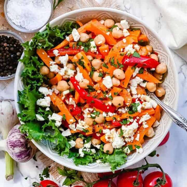 Roasted Pumpkin Chickpea and feta salad - A Delicious bowl of salad loaded with Pumpkins, bell peppers, carrots, Chickpeas and salty Feta. All this goodness is dressed in Maple Chili Dressing to add that little extra touch. -The Yummy Bowl