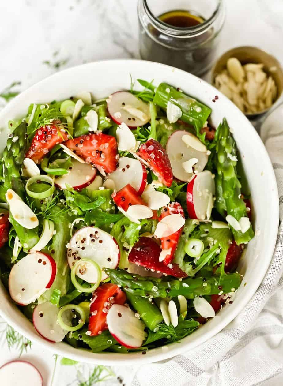 This strawberry asparagus salad is crisp, healthy, and vibrant. This fresh salad is full of flavors and tossed with easy honey balsamic dressing - The Yummy Bowl