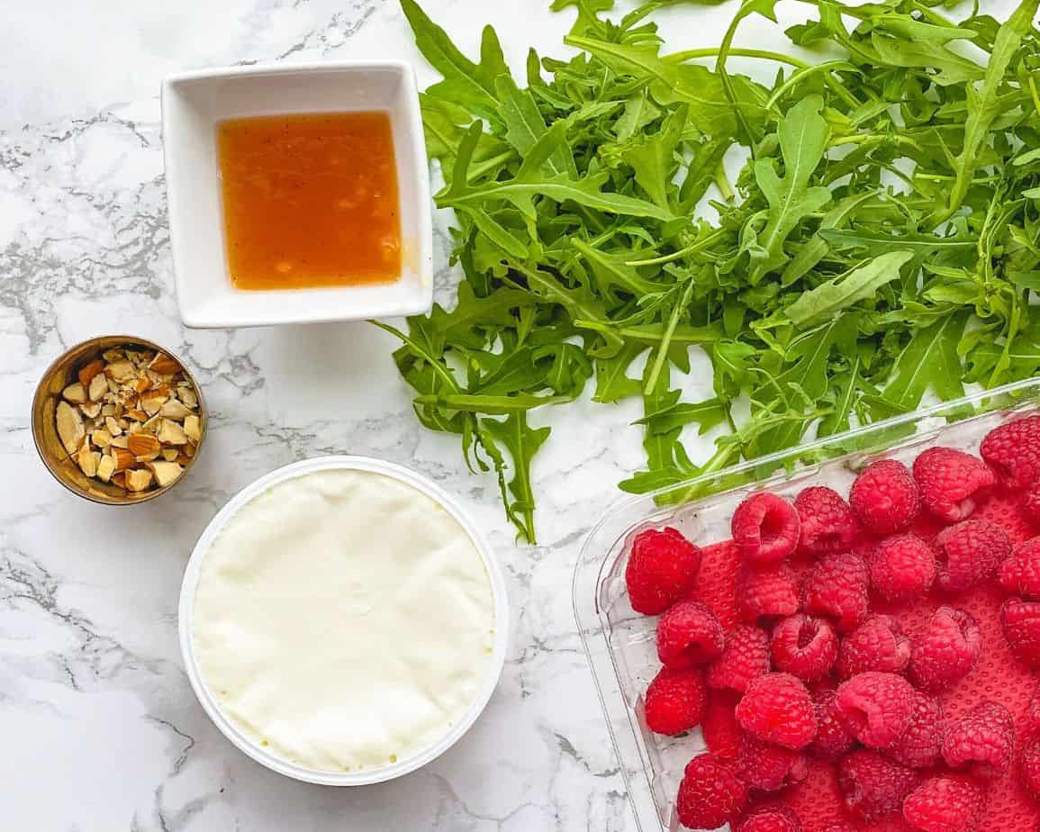This tasty Raspberry apple sauce flatbread is made with my flatbread crust recipe and topped with goat cheese, a bit of honey, almonds, arugula and flavourful balsamic glaze.