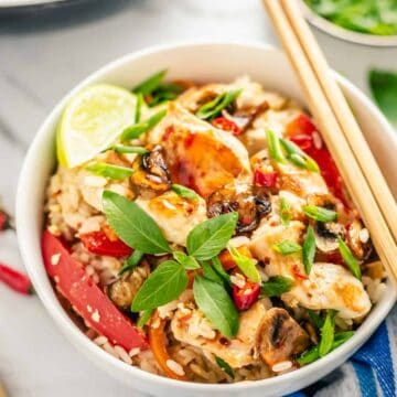 thai chicken fried rice in a bowl with chopsticks
