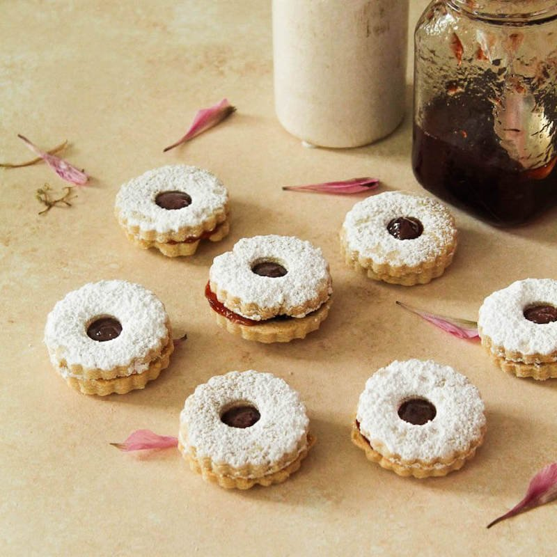 Linzer cookies with jam on a table