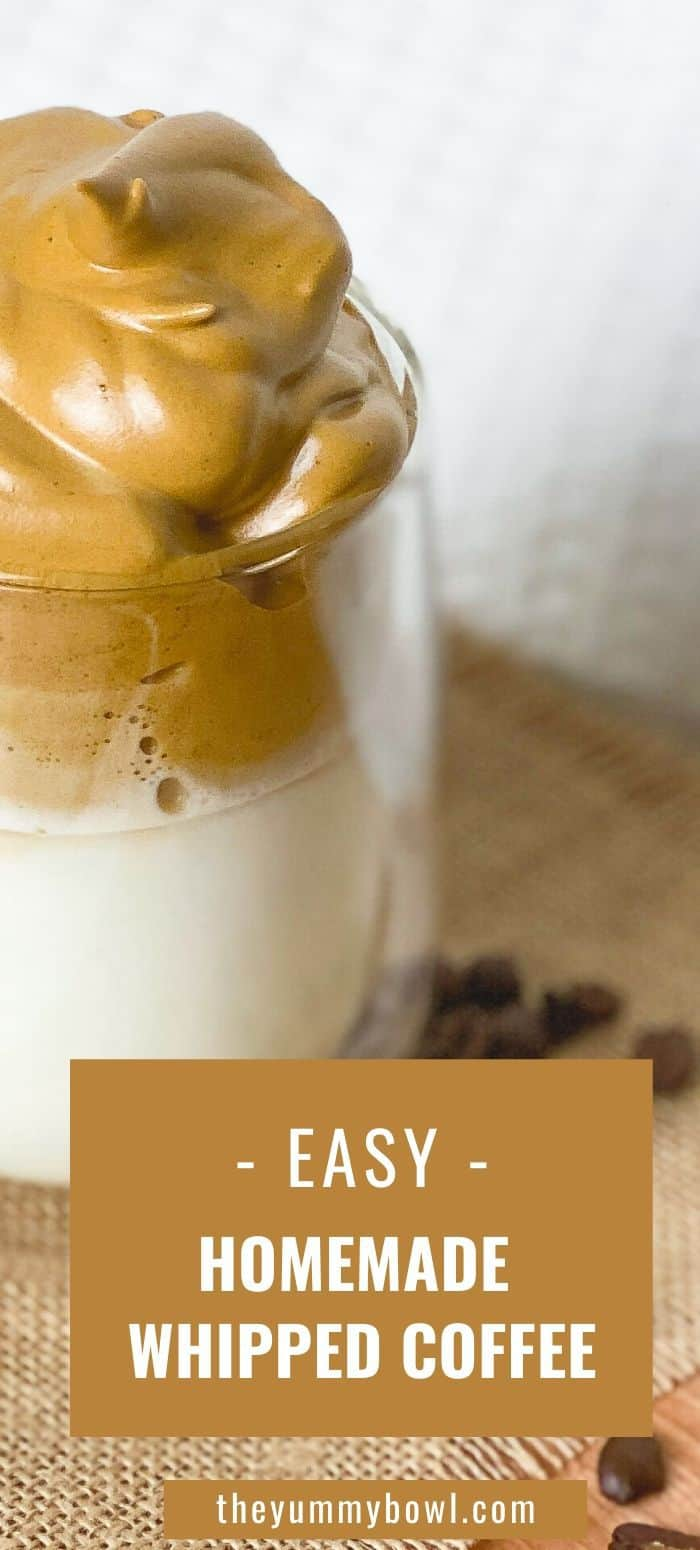 This Dalgona Whipped Iced Coffee recipe calls for four simple ingredients to make the best homemade iced coffee drink. Indulge yourself in the most delicious iced drink with fluffy clouds of whipped coffee over milk. An easy, creamy and superb refreshing drink to enjoy this summer. It only takes about 5 minutes to whip up! #whippedcoffee #dalgonacoffee #icedcoffee #frappe #icedlatte #vegan- The Yummy Bowl